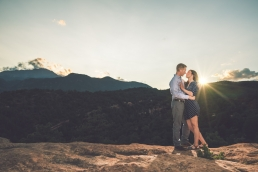 engaged couple almost kissing at sunset in front of pikes peak in colorado