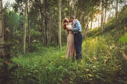 couple kissing in the aspen trees duiring sunset