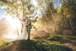 bride and groom kissing in the middle of yellow aspens