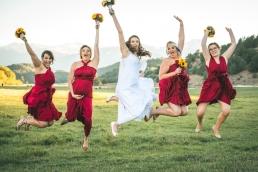 bride and bridesmaids jumping in the air at a wedding