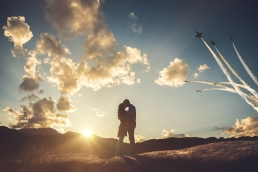 engaged couple kissing at sunset while the blue angels fly above photoshop