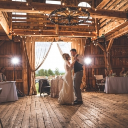 bride and groom first dance in a wooden barn in woodland park colorado