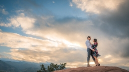 couple in front of sunset at garden of the gods