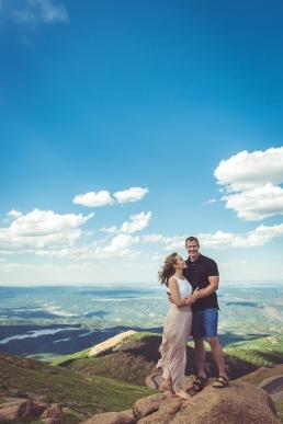 engaged couple on a mountain top - Pikes Peak Colorado