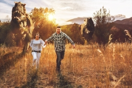 engaged couple running from dinosaurs T-rex photoshop composite