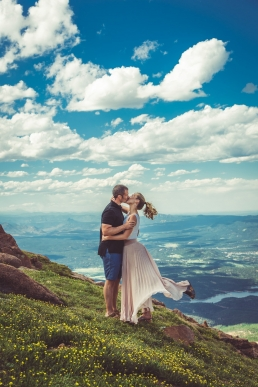 engaged couple kissing on a mountain top - Pikes Peak Colorado