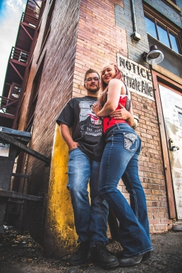 engagement photo of a couple in an alleyway