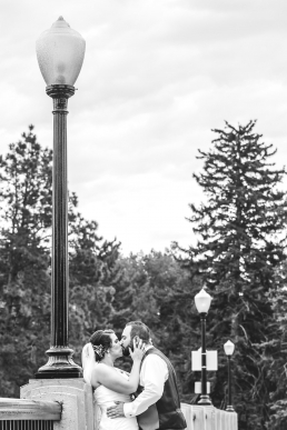 bride and groom kissing under a lamp post