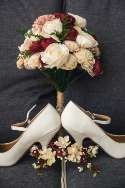 wedding shoes plus wedding rings in a bouqet of paper flowers - foam flowers
