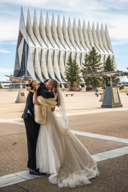 bride and groom hug after a first look at the air force academy in colorado