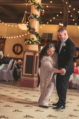 groom dancing with mother of the bride