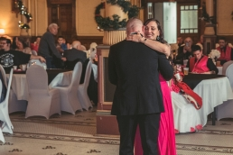groom dancing with sister