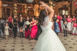 bride throwing the bouqet