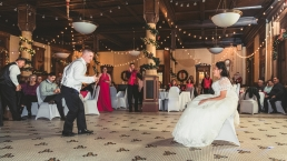 groom dancing for his bride