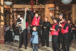 groomsmen jump for the garter