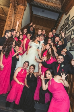 28 people in a wedding party on stairs