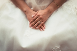 brides hands resting on her dress