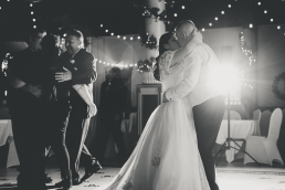 bride and groom kissing on teh dance floor