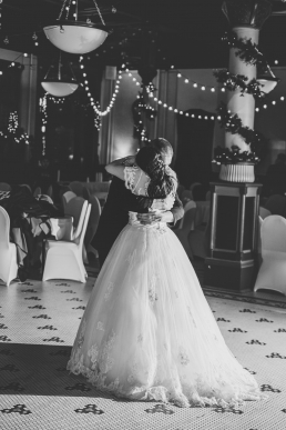 bride and groom hugging on teh dance floor