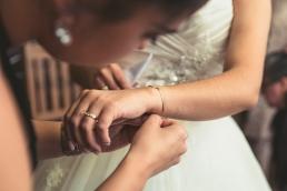 putting on brides bracelet