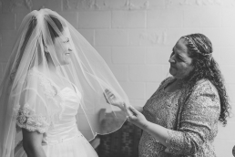 bride and mother looking at each other