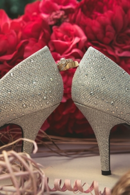 wedding rings and shoes with flowers