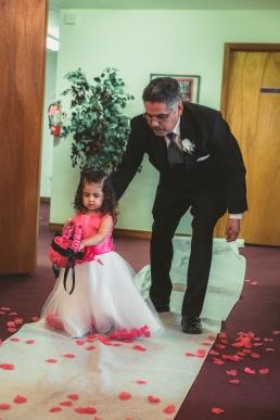 grandpa pushing flower girl down the aisle