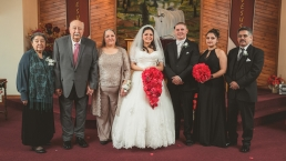 formal photo of the bride and groom and family