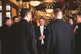 groom staring through his groomsmen