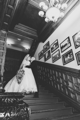 bride and groom kissing on teh stairs at union station in pueblo colorado
