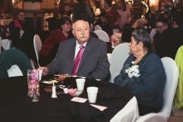 grandparents eatign at a wedding