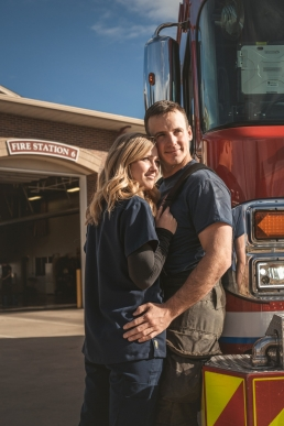 engagement photo with fireman and fire truck