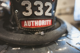 wedding rings on a fireman hat