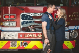 engagement photo in front of a fire truck